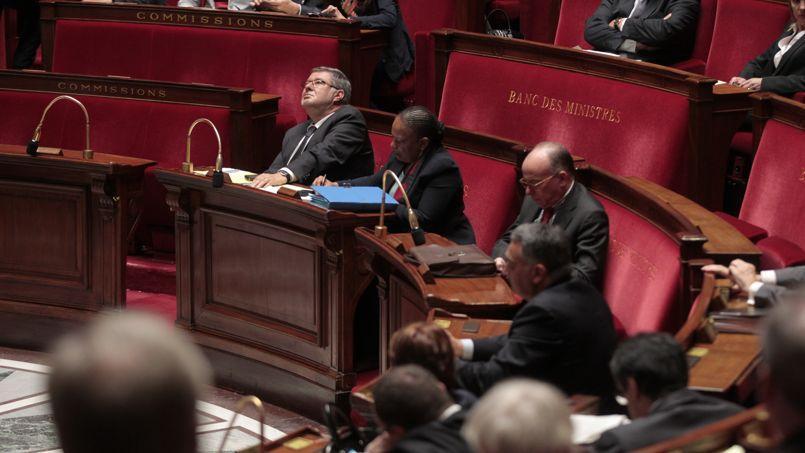Alain Vidalies, Christiane Taubira et Bernard Cazeneuve lors des votes du projet de loi sur la transparence de la vie publique à l'Assemblée, mardi.