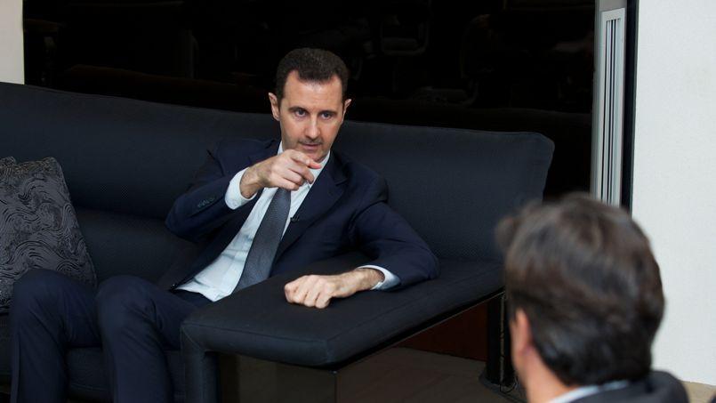 Georges Malbrunot pendant son entretien, lundi à Damas, avec le président syrien.