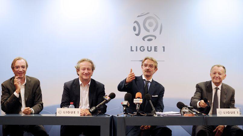 Frédéric Thiriez, président de la Ligue de football professionnel, à gauche du président de l'OL, Jean-Michel Aulas