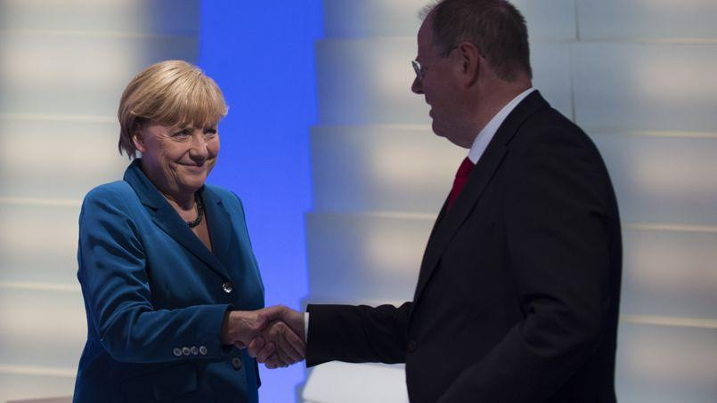 Le SPD envisage de vendre chèrement son soutien à Merkel