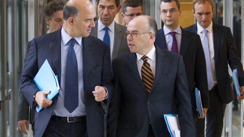 Pierre Moscovici (à gauche), ministre de l'Économie, et Bernard Cazeneuve, ministre du Budget.