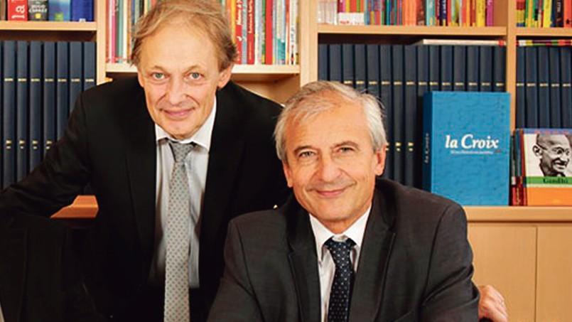 Georges Sanerot, président du directoire de Bayard Presse (à gauche), et Hubert Chicou, directeur général du groupe.