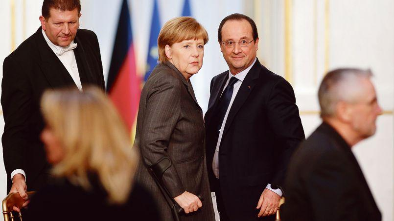 Angela Merkel et François Hollande, mercredi, à l'issue du Conseil des ministres franco-allemand à l'Elysée.