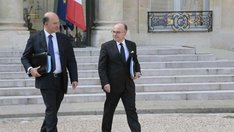 Pierre Moscovici, ministre de l'Economie et des Finances, et Bernard Cazeneuve, ministre du Budget. Crédit: Jacques Demarthon/AFP.