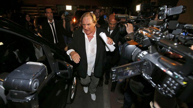 Après Le Loup de Wall Street de Martin Scorsese avec Leonardo DiCaprio, voici Le Cochon de Manhattan d'Abel Ferrara avec Gérard Depardieu dans le rôle de DSK (ici à son arrivée à Cannes).