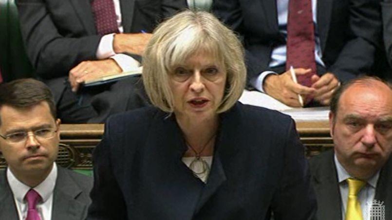 La ministre britannique de l'Intérieur, Theresa May, lundi, devant la Chambre des communes.