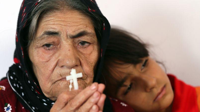 Une réfugiée chrétienne en prière, à Arbil, le 27 juin dernier.