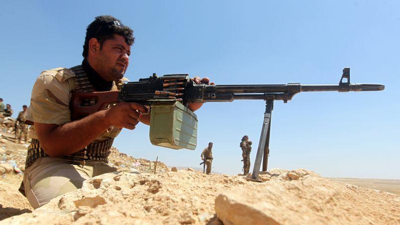 Un peshmerga kurde, le 12 août, au cours de combats contre l'État islamique.