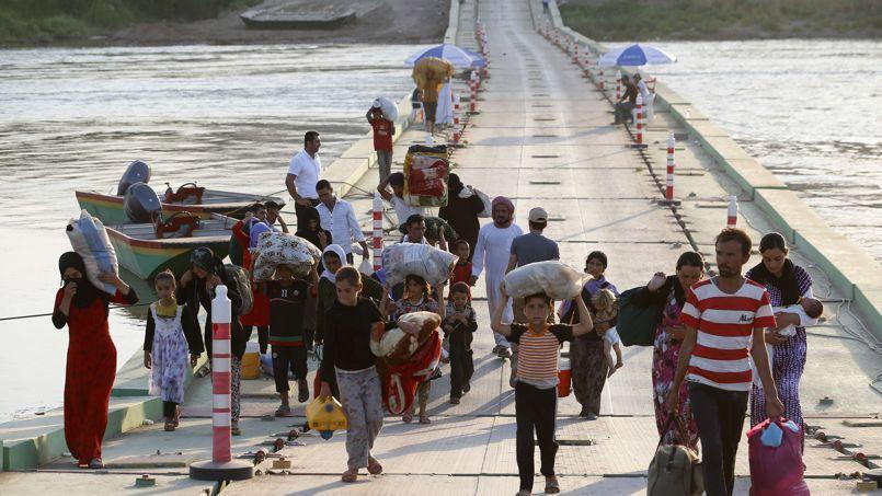 Menacés par les djihadistes, les yazidis fuient la ville de Sinjar. Photo prise le 14 août 2014.