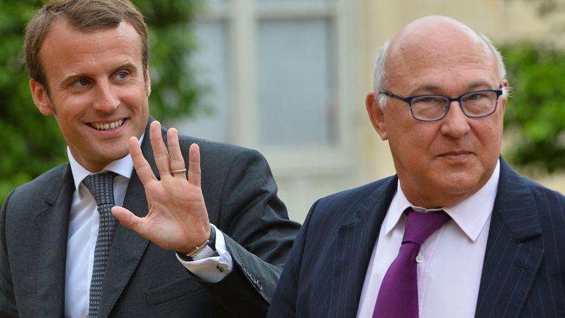 Emmanuel Macron et Michel Sapin, mercredi au Conseil des ministres
