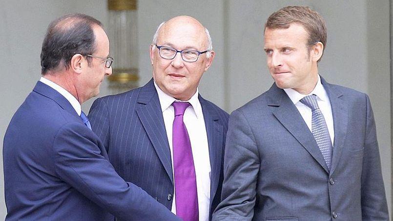 François Hollande, Michel Sapin et Emmanuel Macron.
