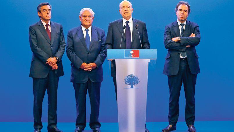 François Fillon, Jean-Pierre Raffarin, Alain Juppé et Luc Chatel au siège de l'UMP, en juillet.
