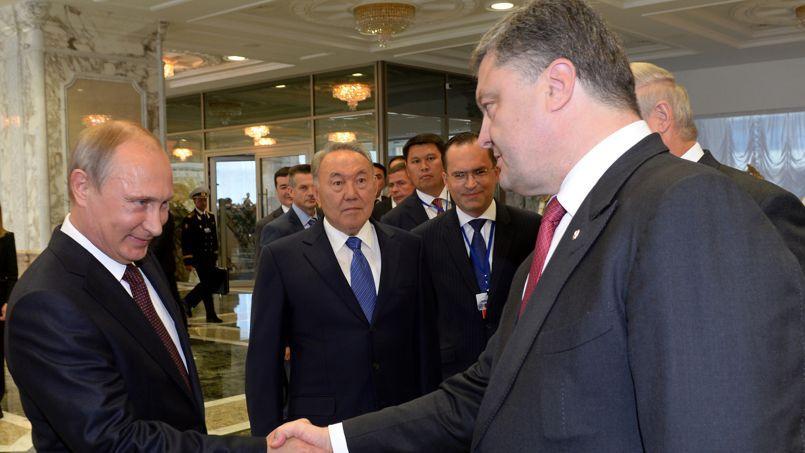 Le président russe, Vladimir Poutine et son homologue ukrainien Petro Porochenko, le 26 août.