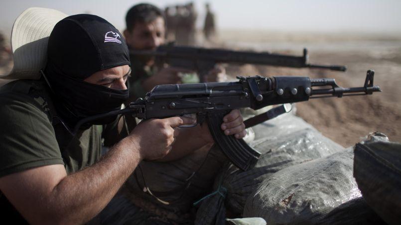 Un soldat Peshmerga garde un point de passage, le 11 septembre.