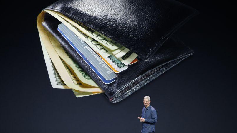 Apple (ici, son PDG Tim Cook présentant la semaine dernière le système Apple Pay), comme Google ou Amazon sont dans le collimateur des États du G20 en raison de leurs astuces d'optimisation fiscales.