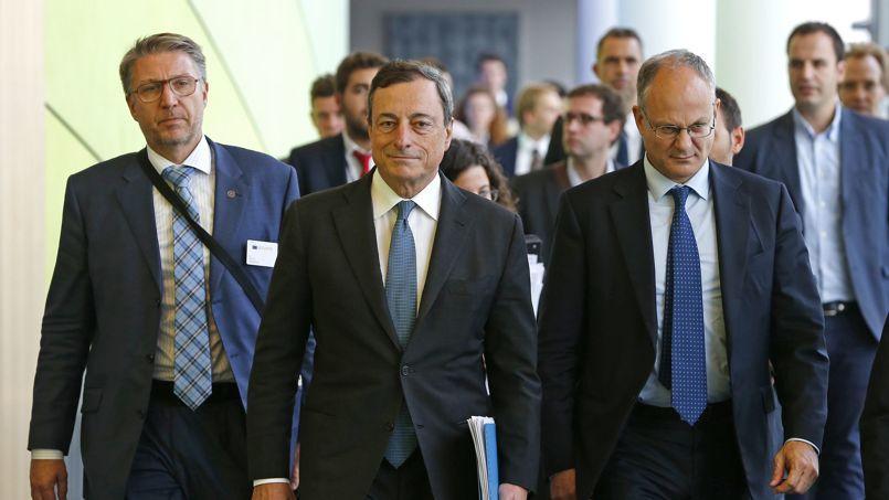 Le président de la BCE, Mario Draghi (au centre), à Bruxelles le 22 septembre.