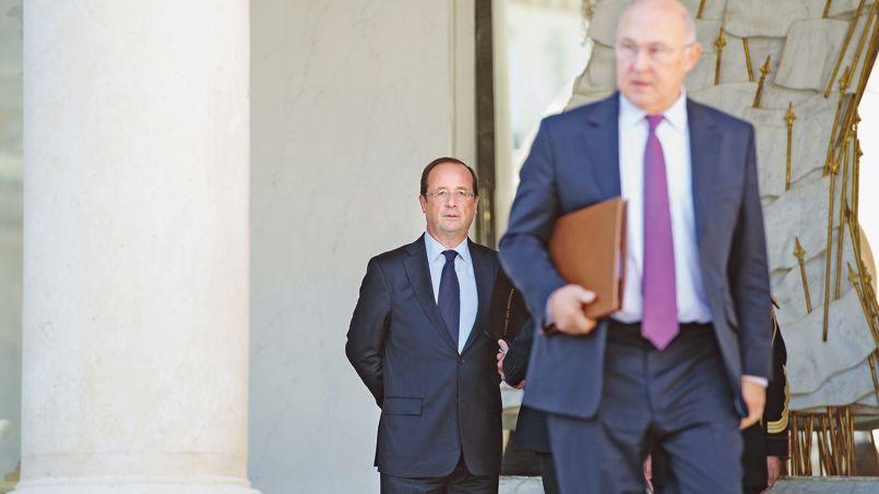 François Hollande et Michel Sapin.