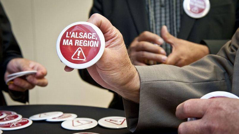 Badges du collectif «L'Alsace, Ma région» à l'origine de la manifestation de samedi contre la fusion des régions. Crédits photo: L'Alsace, Ma Région.