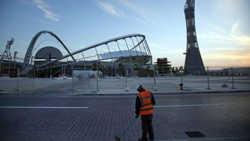 Plus de 500ouvriers sont déjà décédés sur les chantiers du Mondial 2022 au Qatar (Crédit: Kin CHEUNG / AP)