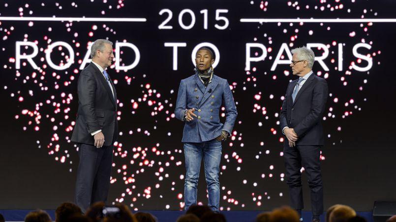 Pharrell Williams, entouré d'Al Gore, ancien vice président américain et Kevin Wall , producteur américain, parlent climat à Davos.