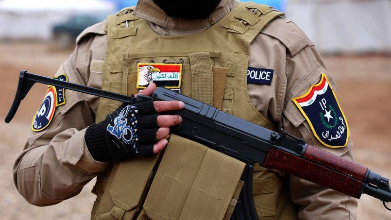 Un policier irakien au camp d'entraînement au nord-est de Mossoul le 10 Janvier 2015.