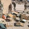 Fouille d'une maison et découverte d'un dépôt de munitions (photo récupérée auprès de l'armée tchadienne).