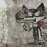 On discerne encore sur les murs décrépits un dessin de la mascotte officielle des JO de Sarajevo, Vucko.