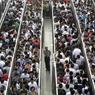 D'impressionnantes files d'attente d'usagers se sont formées devant certaines stations du métro de Pékin, où de nouvelles mesures de sécurité ont été mises en place cette semaine, avant l'anniversaire de la répression du mouvement pro-démocratie de Tiananmen.