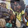 Un graffiti réalisé par les membre d'OPNI, acronyme désignant un groupe de graffeurs «non identifiés», à São Paulo. Le groupe a été créé en 1997 avec pour but de transformer les rues des bidonvilles en galeries d'art à ciel ouvert, tout en dénonçant les injustices sociales.