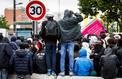 Immigration: ferme dans les mots, Macron est attendu sur les actes