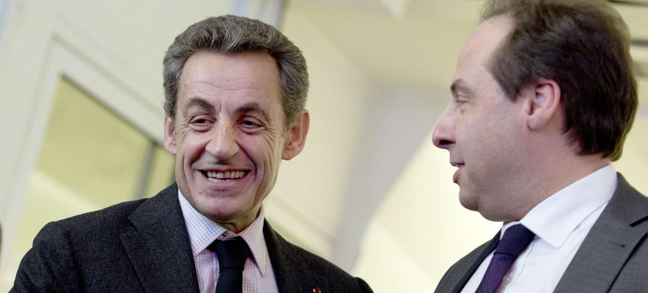 Nicolas Sarkozy en compagnie du chef de file de l'UDI, Jean-Christophe Lagarde, lundi, au siège de l'UMP à Paris