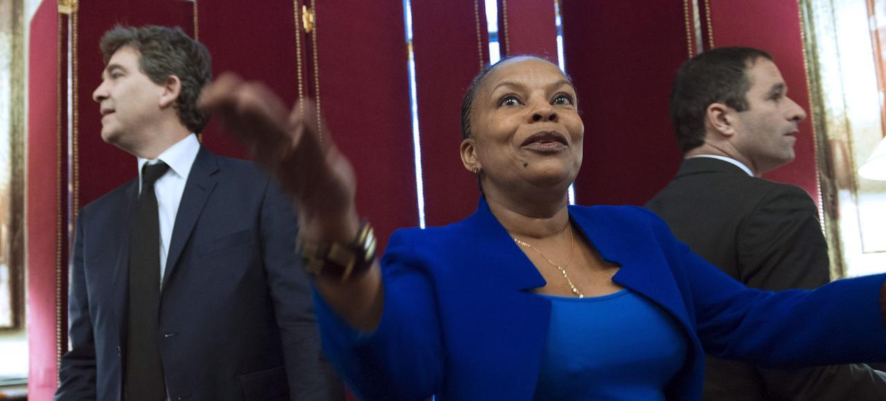 Christiane Taubira entourée d'Arnaud Montebourg et de Benoît Hamon, en décembre 2012, au ministère de la Justice, à Paris.