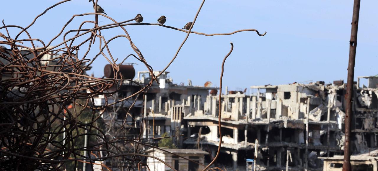La province de Homs (ici la ville dévastée, le 5 février) pourrait bénéficier d'un arrêt prochain des violences syro-russes contre les anti-Assad.