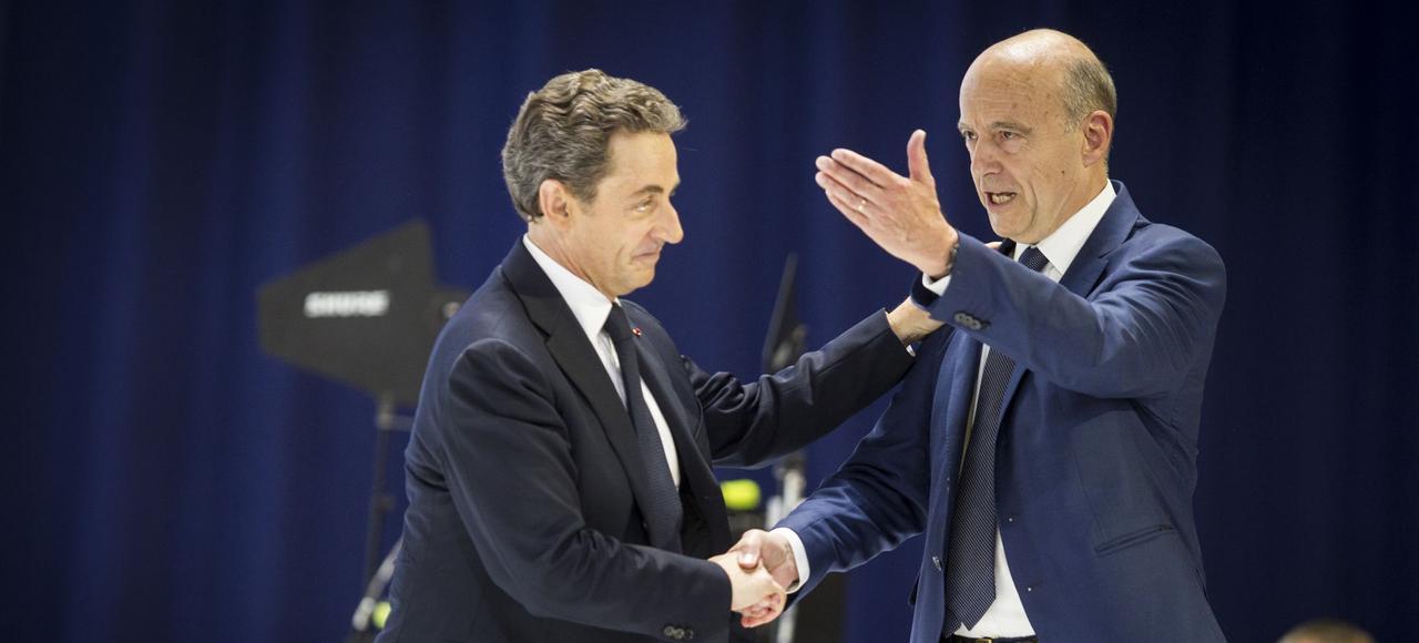 Nicolas Sarkozy et Alain Juppé, lors du congrès fondateur des Républicains, le 30 mai 2015.