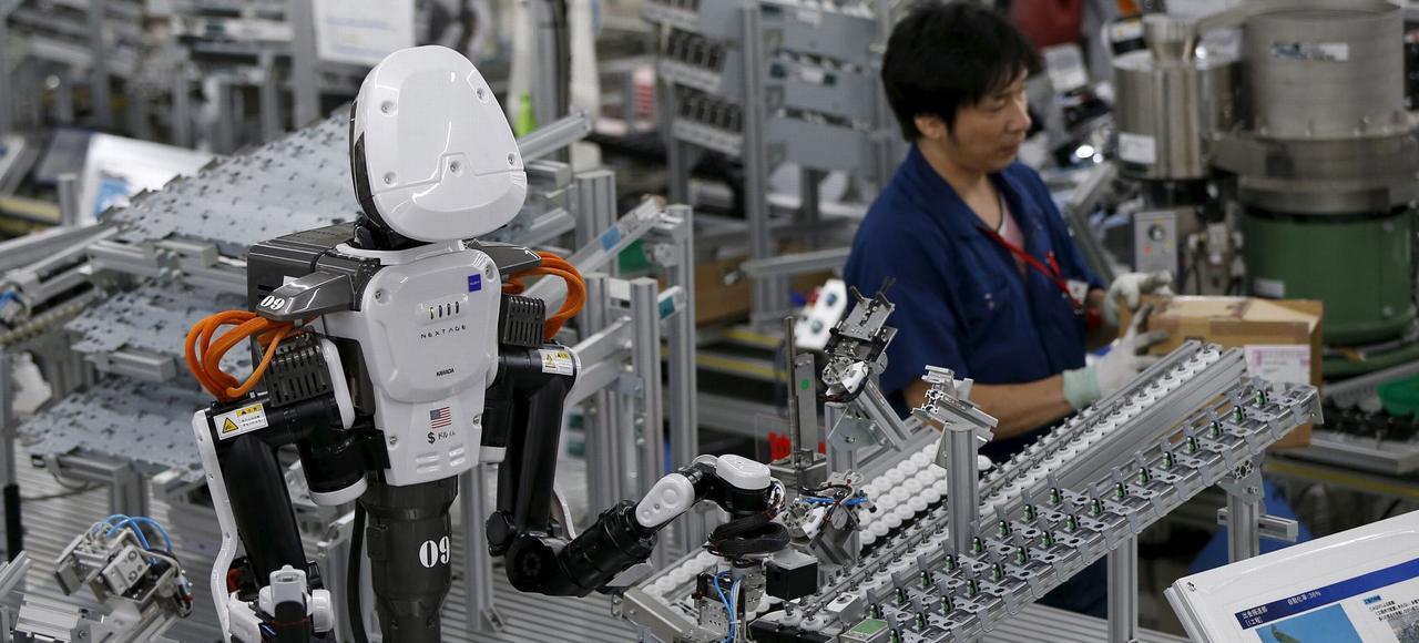 Un robot humanoïde au travail dans une entreprise de Kazo, au nord de Tokyo, au Japon.