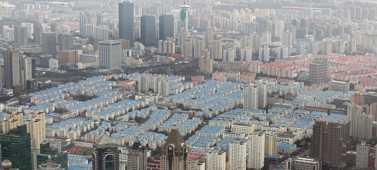 Un programme de logements neufs, à Shanghaï. Face au risque de bulle immobilière, les autorités ont annoncé de nouvelles mesures de restrictions, qui pourraient, selon certains experts, entraîner un contrecoup sur la croissance.