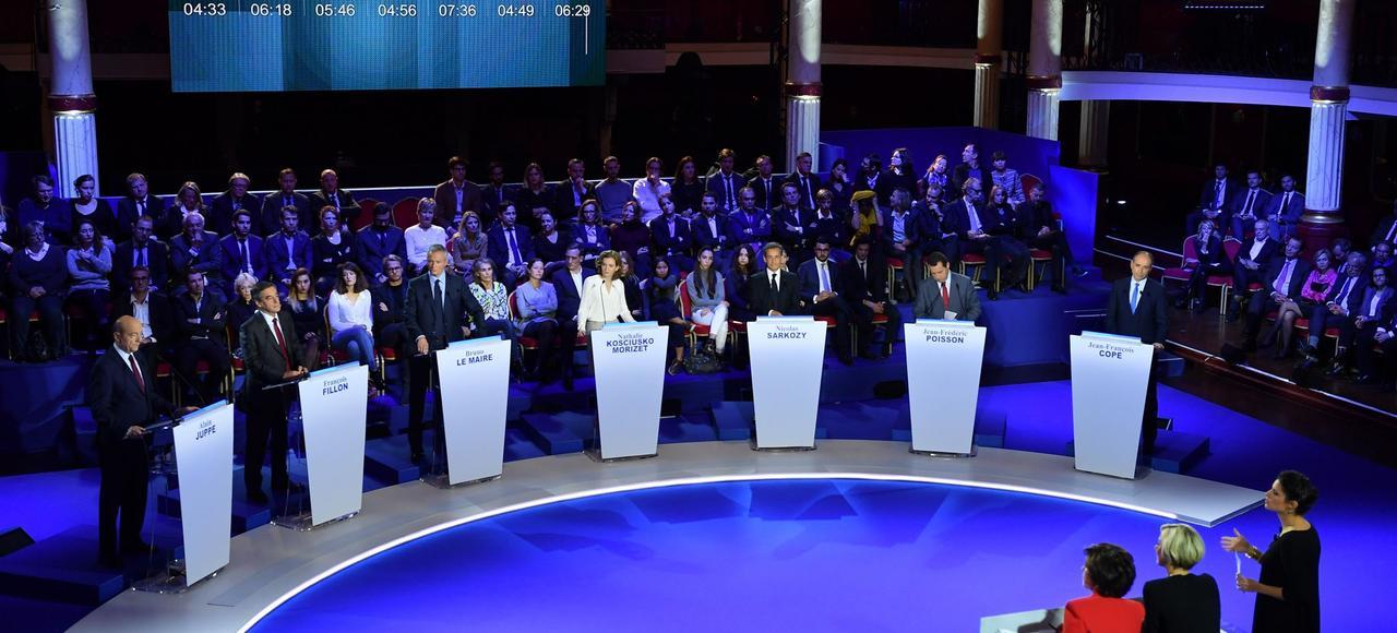 Alain Juppé, François Fillon, Bruno Le Maire, Nathalie Kosciusko-Morizet, Nicolas Sarkozy, Jean-Frédéric Poisson et Jean-François Copé lors du deuxième débat télévisé.
