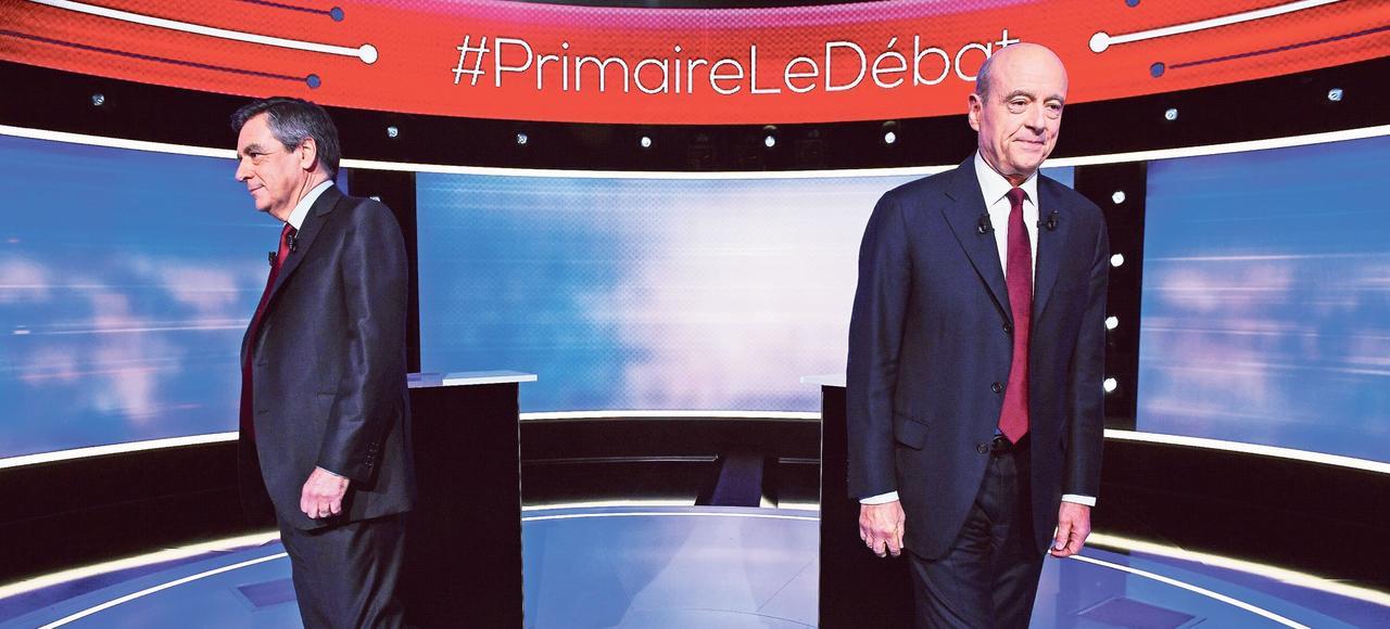 Francois Fillon et Alain Juppé sur le plateau de télévision, avant le débat de jeudi soir.