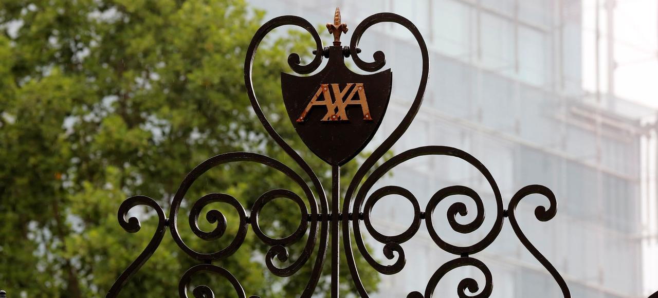 L'action Axa (ici l'entrée du siège, Paris) a gagné 23,41% en six mois.