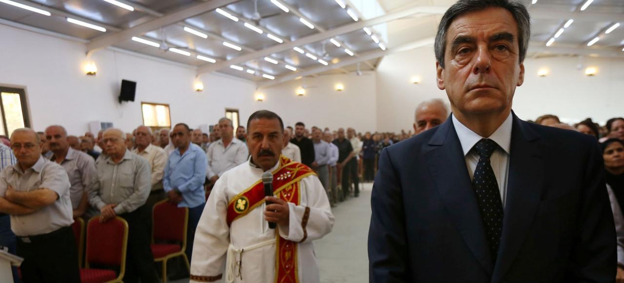 François Fillon participe à une messe aux côtés de réfugiés chrétiens irakiens, en l'église de Mar Shmony, à Erbil (Kurdistan irakien), le 5 juin dernier.