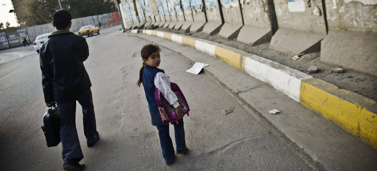 Outre les attentats (ici, un mur anti-explosion), les habitants de Bagdad redoutent de se faire kidnapper.