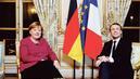 Discret coup de main de Macron à Merkel pour bâtir sa coalition