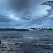Il tracte des bateaux avec une voile de kite