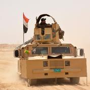 Face à l'EI dans Mossoul, trois forces antagonistes attendent l'arme au pied