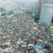 Pékin resserre le robinet du crédit pour dégonfler les bulles