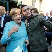 Harcelé depuis un selfie avec Angela Merkel, un Syrien assigne Facebook en justice