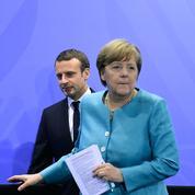 Face à Trump, Merkel et Macron veulent unir les Européens