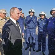 Poutine annonce le retrait d'une «partie significative» des forces russes en Syrie
