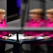 Merkel promet de lutter contre les divisions de l'Allemagne