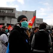 Macron accueilli par des huées de manifestants à Rouen